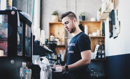 Young man working in cafe